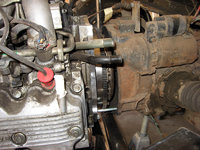 Align the transmission input shaft and engine mating bolts and slowly work the motor toward the transmission.