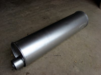 This is a muffler from a 1996 Ford F150 with a 6 cyl. engine. It produces a very quiet exhaust at idle but growls like a tiger at full throttle. It is only slightly larger than a stock Vanagon muffler and less than half the cost as well!