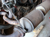 Our 1984 Vanagon exhaust was pretty rusted out. Try to remove the catalytic converter and muffler assembly from the Waterboxer motor using the bolts - you may need to grind them off.