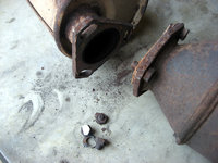 I had to grind off the rusted bolts to free the catalytic converter from the muffler.