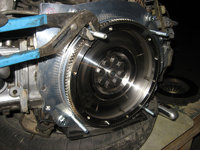 Torque flywheel to motor (51-55 ft. lbs.) and replace motor studs with KEP supplied studs.