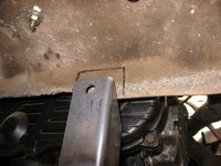 The KEP supplied muffler bracket rubs on the rear engine tin slightly so we marked it and cut it out using tin snips.
