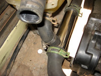 Place the Tee fitting near the coolant bottle bracket and attach all the newly cut radiator hoses. Make sure the small 90 degree branch hose is as vertical as possible to allow air bubbles to rise into the coolant bottle.