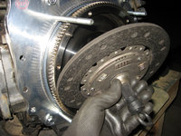 Using a VW clutch alignment tool place the clutch onto the flywheel assembly.