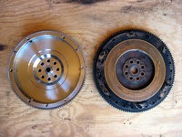 KEP custom flywheel on left. Subaru flywheel on right.