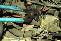 Use pliers to remove the hose clamps for the water hoses.