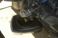 3. First unscrew the cap and drain the hydraulic fluid.  Properly contain and dispose this fluid.